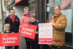 Claudia Beamish MSP  (far right) outside the  Lanark Santander branch earmarked  for closure