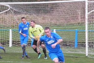 Lanark Uniteds Lewis Hill (pictured, first left) put his team ahead against Lesmahagow Juniors, before keeper Gareth Hallford (centre) later earned his team a point with a brilliant second half penalty save from Kyle Weir (Library pic)