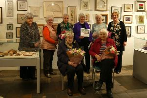Members of Biggar Embroirdery Guild are staging an exhibition in conjunction with the Scottish Diaspora Tapestry at New Lanark, celebrating the group's 40th anniversary.' And they recently toasted long-serving members at a celebration lunch at the World Heritage Site.