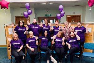 Best foot forward...a 30-strong team at Woodstock Medical Centre in Lanark have notched up millions of miles this month for Cancer Research UK.