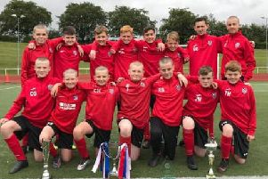 Carluke United under-13 squad with trio of trophies (Submitted pic)