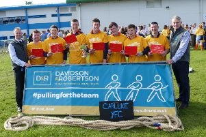 Pulling their weight...Carluke YFC men's team won the regionals, beating local rivals Biggar YFC and went on to win the spoils in the final.