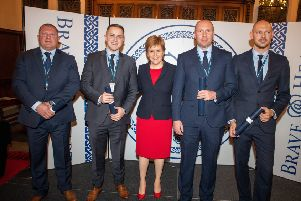 Sgt Mark Chivers, PC Chris Mains, PC Neil McBain & PC Darren Connor who helped stop and restrain a man intent on jumping from a 12th story window, putting their own lives at risk received their awards this evening during an awards ceremony at Edinburgh Castle from the First Minister 'Pic Kenny Smith,