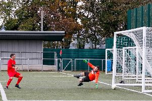 Stephen Larkin scores for Carluke after Port Glasgow keeper had saved initial effort (Pic by Kevin Ramage)