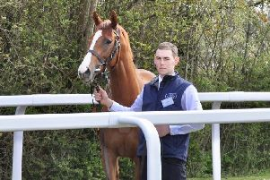 Andrew McIntyre leads Royal Intervention, trained at Lambourn, after it had won a Group Three race at York