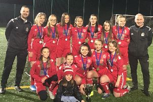 Graeme Winning (1st left) is pictured with the title-winning Kirkfield United under-13 girls squad and fellow coach Damian Murphy (Submitted pic)