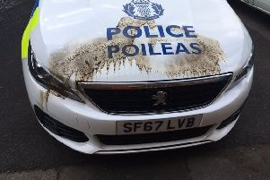 An attempt was made to set fire to a police car parked outside Maybole Police Station.