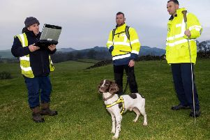 Iain Hall, Craig Garment and Luke Jones with Denzel the Scottish Water sniffer dog