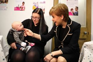 First Minister Nicola Sturgeon during a visit to One Parent Family Scotland in Glasgow in December when she announced  the first payments of the Best Start Grants Pregnancy and Baby Payments.