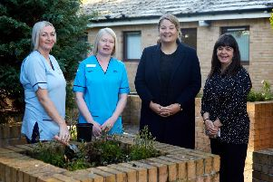 Kirsty Lewis Asst Practitioner, Jenny Preston, Clinical Lead Neurological Rehabilitation, Ruth McGuire, MSP and Alison Keir Policy Officer Scotland  at the garden where OT takes place.