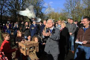 Cumbernauld Environmental Society (CES) chairman Bobby Johnstone releases a bird at the opening of Cumbernauld Community Memorial Peace Garden in Greenfaulds