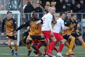Kevin Nicoll and Ally Love await delivery of a ball into the box at Annan (pic by Alan Watson)