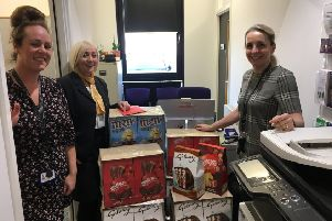 Fosters Family Funeral Directors teamed up with North Lanarkshire Women's Aid to deliver 50 Easter Eggs