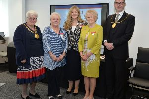 British Empire Medal recipients Elizabeth Rice (in blue) and Elizabeth Wilson (in yellow) at the ceremony with North Lanarkshire provost  Jean Jones, Lord Lieutenant of Lanarkshire, Lady Susan Haughey and South Lanarkshire provost Ian McAllan
