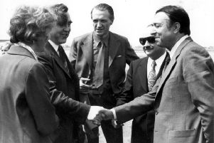 Provost Murray meeting Mayor Sousi of Bron (Cumbernauld's twin town) at an airport (with other officials). 1975