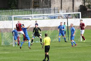 Cumbernauld's Paddy McCabe heads for goal during his side's derby win over Kilsyth Rangers at Duncansfield.