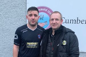 Cumbernauld United skipper and man of the match Tony Stevenson with sponsor Grant Law after their 4-0 win over Whitletts Victoria