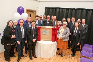 North Lanarkshire provost Jean Jones unveils a plaque at the official opening of the new Cumbernauld Academy