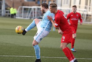 Tom Lang challenges Forfar's Steven Doris. (Pics by Chris Coutts)