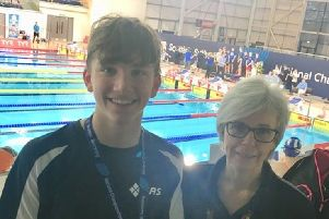 Scottish champion William Storer and his coach Birgit Hutcheon at the Scottish Age Group Championships in Glasgow