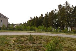 The path of the proposed distributor road is through forestry and close to housing