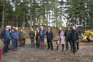 Committee members, NHS staff and trustees gather at the site to cut the first sod.