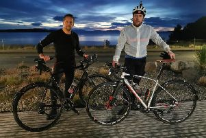Calum, right, pictured recently during a cycle on Scotland's North West Coast