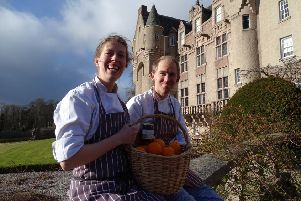 Louisa Bradford and Rupert Holden in front of Kincardine Castle