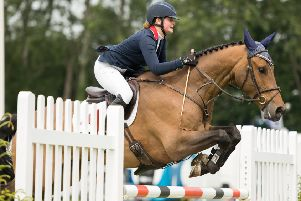 Nicole Lockhead Anderson and Here I Am B jump to it on their way to success in the Kingsman 7&8 Year Old Championship at Hickstead. Picture by Lotte Simons