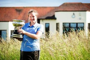 Kimberley Beveridge with the Scottish Amateur championship trophy.