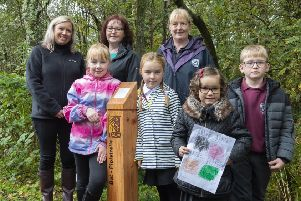 Elrick pupils with, from left, Sian Mutch of Taqa, Cllr Iris Walker, and Alison Sutherland, of the Ranger Service. Picture: Aberdeenshire Council