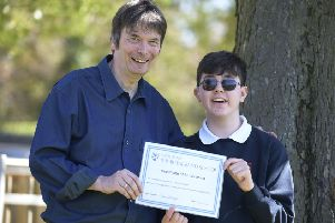 Ian Rankin presents Andrew Pettigrew with his certificate. Picture: Sandy Young