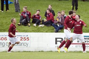 Linlithgow Rose's jubilant players join Colin Strickland after he put the Prestonfield side 2-0 up on Bo'ness. Pic: Craig Halkett