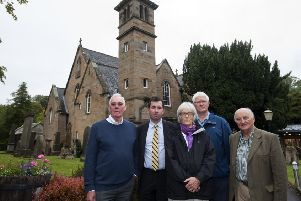 Councillor Jason Rust, second from left, joined other community campaigners to block the changes. Picture: Lesley Martin