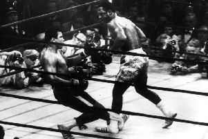 Muhammad Ali goes down in the 15th round to Joe Frazier. Ali and Ken Buchanan shared a dressing room before the fight. Picture: Keystone/Getty Images