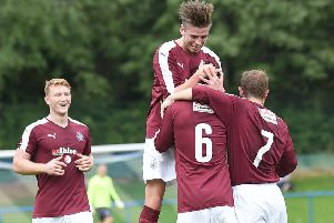 No. 6 Jack Beaumont is congratulated after scoring Linlithgow's second