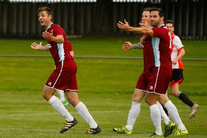 The Whitehill players are incensed after having a goal disallowed for offside. Pic: Scott Louden
