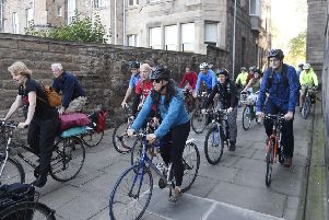 Cyclists in a show of support of a cycle path in Roseburn in August. Picture: Greg Macvean