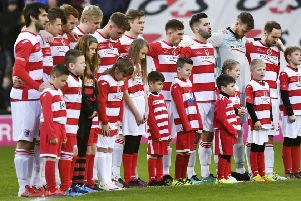 The Bonnyrigg Rose players observe a minute's silence for former player Shaun Woodburn. Picture: Alan Harvey/SNS