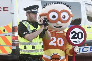Edinburgh Council 20mph mascot with PC Ben Wray to launch the new zones on Tuesday.