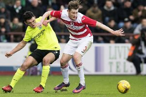 Ruaridh Donaldson, right, battles with Hibs' John McGinn at Tynecastle