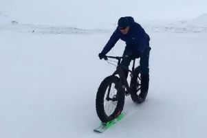 Sir Chris Hoy tries out the 'ski-bike'. Picture: Twitter/@chrishoy