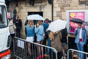 Extras queue outside Cav ahead of T2 filming. Pic: Ian Georgeson