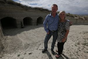 Mark and Shirley Graham in front of the cave before its renovation.