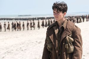 Fionn Whitehead waits for rescue in Dunkirk