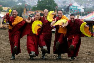 The Gyuto Monks of Tibet pose at Glastonbury Festival