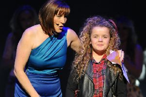 Saskia Eng, pictured with host Arlene Stuart,  winning Edinburgh Has Talent in 2013.  Picture: Ian Rutherford