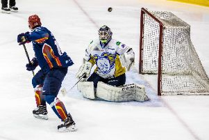 Dylan Anderson watches as a deflected puck flies over Jordan Marr's net. Pic: Ian Coyle
