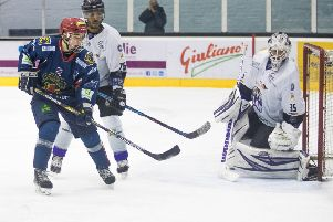 Great Britain U-18 internationalist, Caly Robertson, is closely marked by Braehead's Cameron Burt. Pic: Ian Coyle