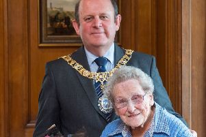 Edinburgh volunteer Doris Keir with the Lord Provost of Edinburgh, Frank Ross, at the City Chambers. Picture: Ian Georgeson